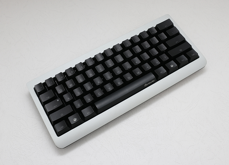 Ducky Mini is constructed with aluminum and plastic sandwich. This gives the keyboard a solid premium feel of aluminum without being overly heavy.